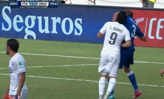 Suarez booted out of World Cup for biting Chielini