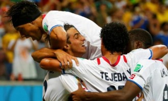 Compact Costa Rica defeat Greece on penalties