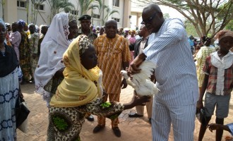 Fayose shares rice, chicken, raw cash in Christmas 'stomach infrastructure' programme