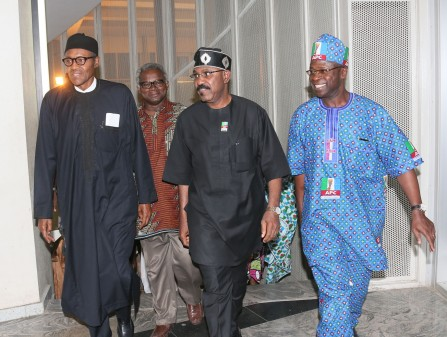 L-R; All Progress Congress Presidential Candidate, General Muhammadu Buhari welcomed by APC Chieftian Mr Osit Senator Olurunmibe Mamora, Mr Rotimi Fashiakin and others as General Buhari returned to Nigeria onboard British Airways flight 083 after weeks of working visit to the United Kingdom  t in Abuja.