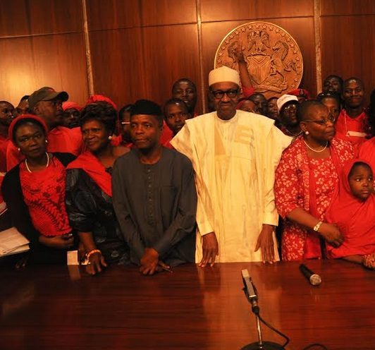President Buhari and vice president Osinbajo in a group photo with Bring Back Our Girls campaigners