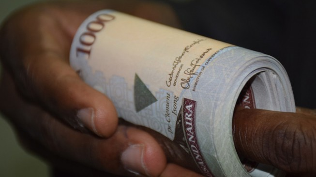 Naira gains, FX reserves sink as stock market hits new high