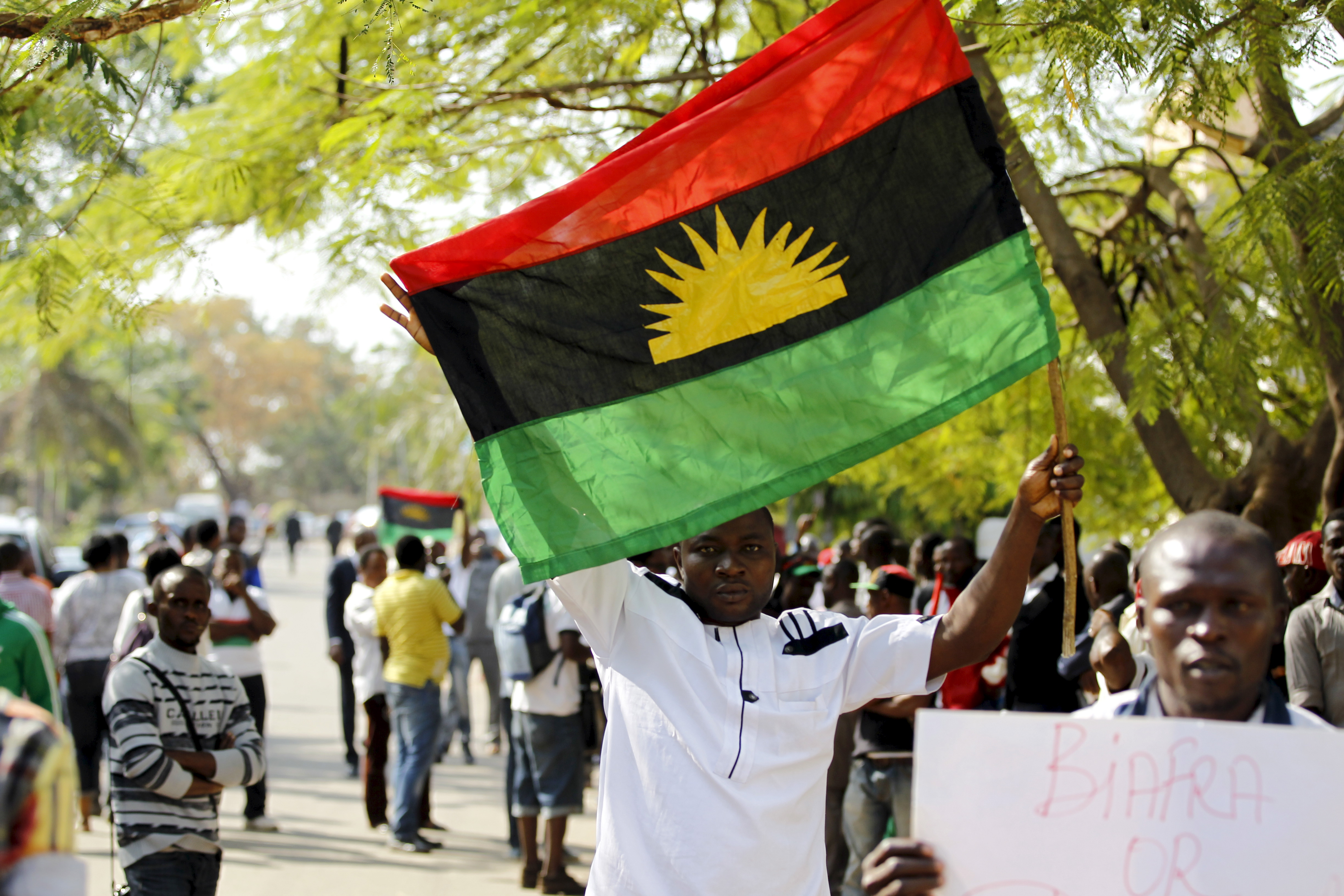 A supporter of Indigenous People of Biafra (IPOB) leader Nnamdi Kanu holds a Biafra flag during a rally in support of Kanu, who is expected to appear at a magistrate court in Abuja