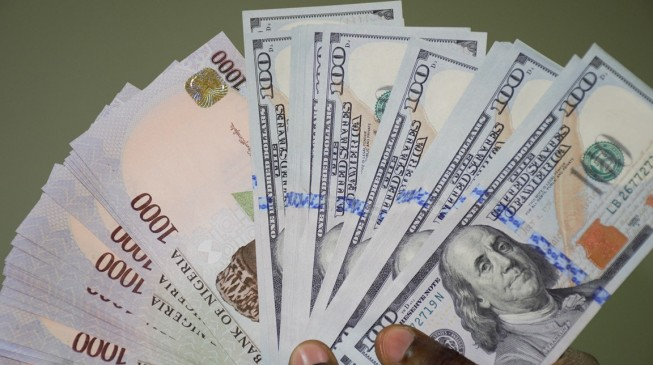 Naira steady, dollar slips while gold gains slightly