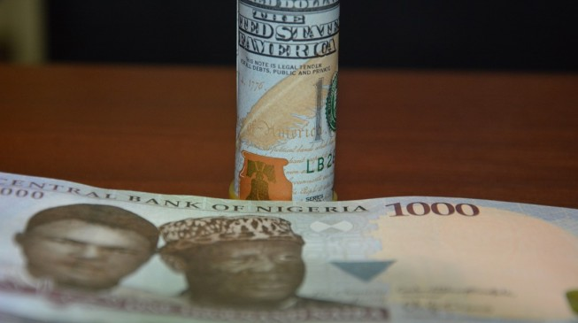 PwC says naira may fall to N386/$
