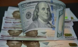 Despite surge in forex reserves, naira closes week at 405/$1