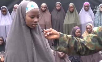All Chibok girls will one day be with their families, says Buhari