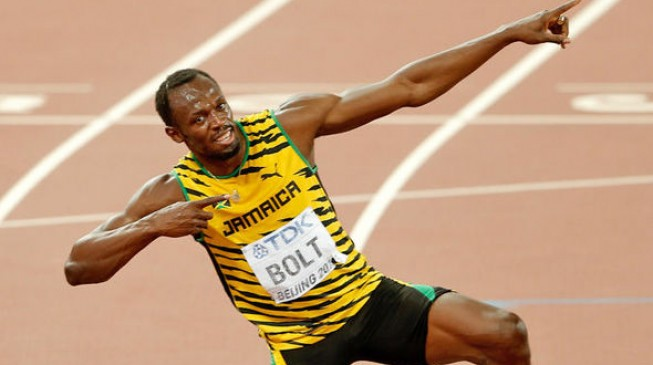 Usain bolts past rivals to make Olympic history