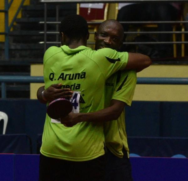 Quadri and Toriola share an embrace