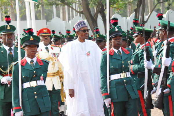 Image result for buhari observes the guard of honour