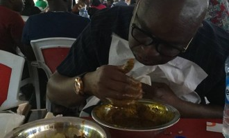 EXTRA: Fayose enjoys amala in Abuja restaurant
