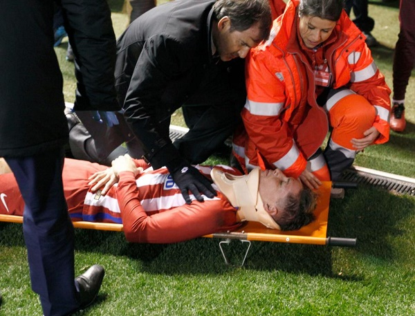 Torres being stretchered off