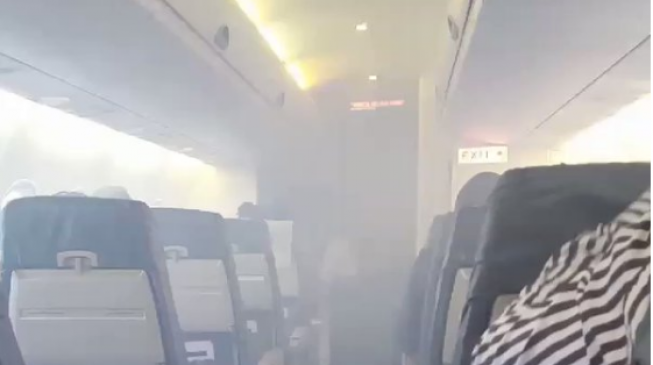 Passengers panic as plane catches fire