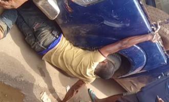 TRENDING VIDEO: Policemen chain civilian to a van in Edo
