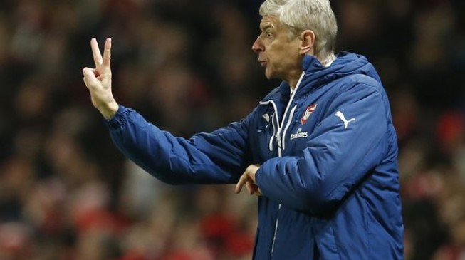 Wenger to target title after signing new two-year deal with Arsenal