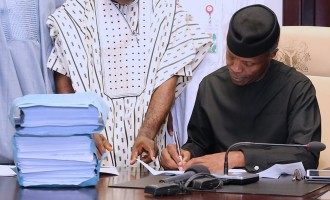 Finally, Osinbajo signs 2017 budget