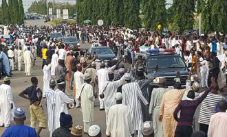 Pro-Buhari protesters block airport road