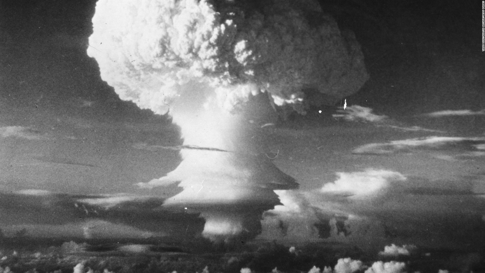 a report on the atomic bomb The story of the atomic bomb started around the turn of the century when a small number of physicists began to think about, discuss, and publish papers about the phenomenon of radioactivity, the behavior of alpha particles, and the properties of various materials when irradiated.