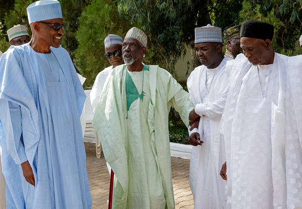 President Muhammadu Buhari (l) with some of his friends  who paid him courtesy visit in Daura, Katsina on Sunday