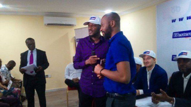 2baba, Olamide present cheques to Western Lotto winners