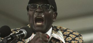 Mugabe fired as leader of ruling party, replaced with vice