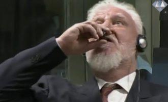 VIDEO: War criminal dies after drinking poison in court