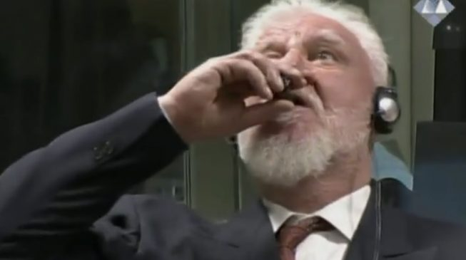 VIDEO: War criminal dies after drinking poison in court