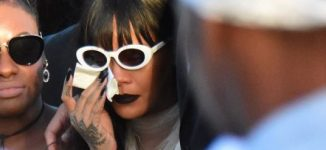 PHOTOS: Rihanna in tears at funeral of slain cousin
