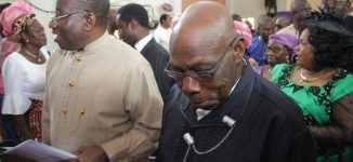 Jonathan, Obasanjo sit side-by-side in church