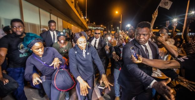 Nigerian bobsled queens return home to heroic welcome