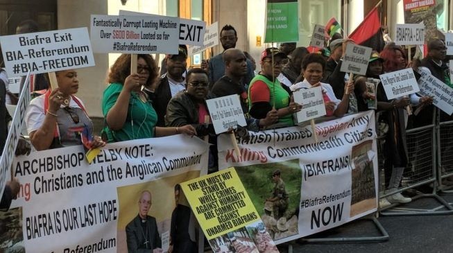 PHOTOS: Biafra protesters storm Westminster as Buhari meets the Queen