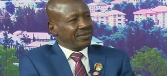 'A dent on our democracy' — Nigerians hit Magu for donning Buhari's reelection lapel