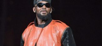 R. Kelly sued by woman he 'forced to film sexual acts', infected with herpes