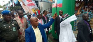 Rain delays APC convention but delegates troop in