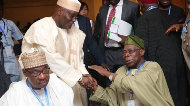 PHOTOS: Aliyu Gusau 'reunites' Obasanjo and Atiku in Abuja