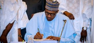 Buhari signs 2018 budget into law