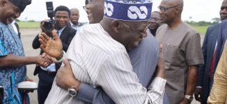 PHOTOS: Tinubu hugs Atiku at Akure airport