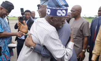 PHOTOS: Tinubu hugs Atiku at Akure airport