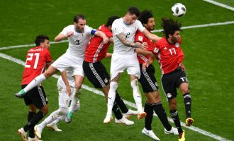 Salah watches as Egypt lose to Uruguay