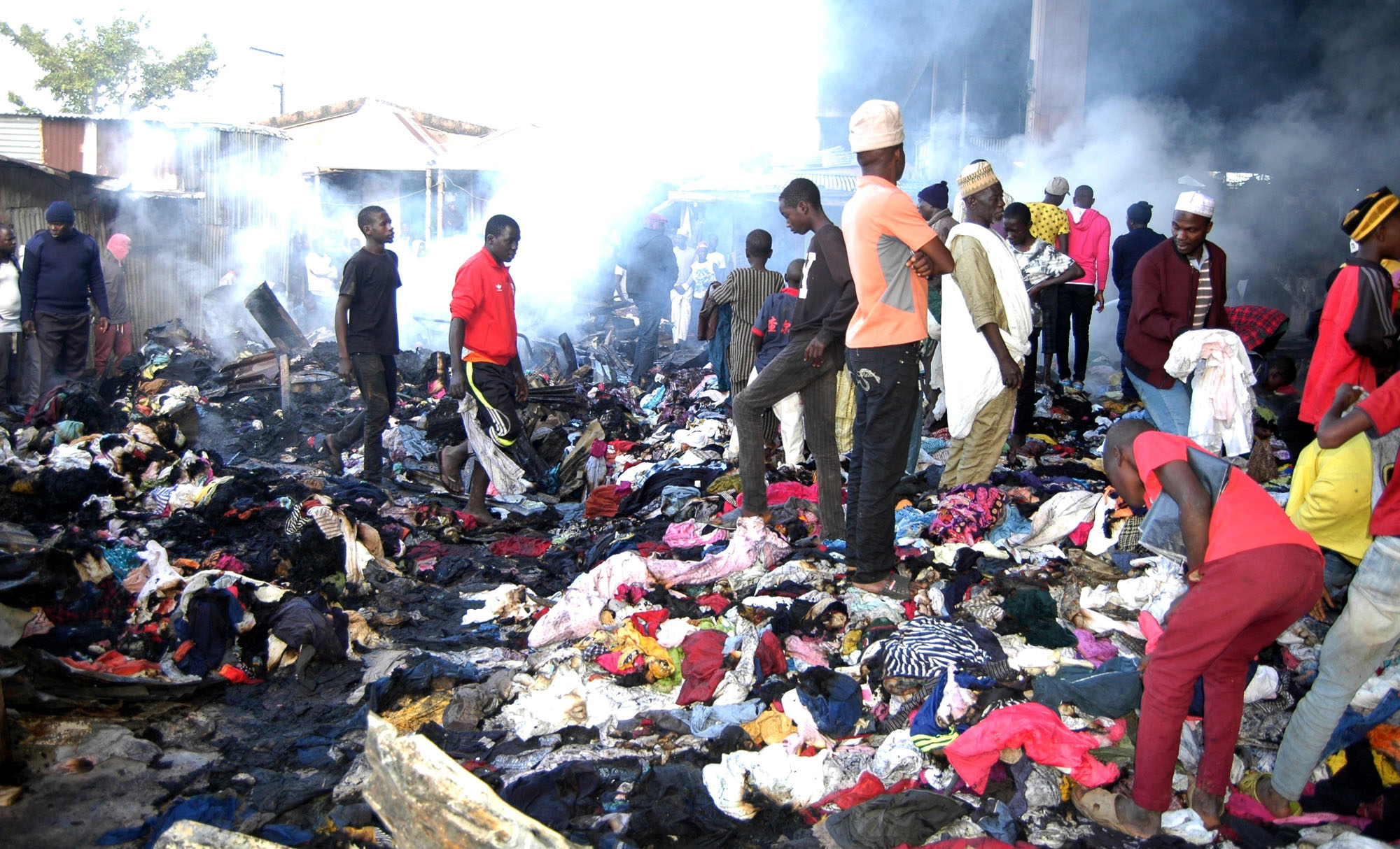 Image result for 270 shops destroyed as fire guts Terminus market in Jos