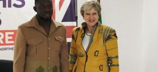 Meet Emmanuel Okoro, designer of jacket worn by Theresa May to Nigeria