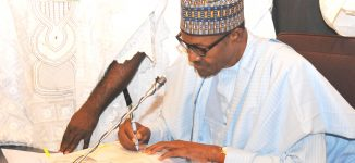 Buhari signs five bills into law