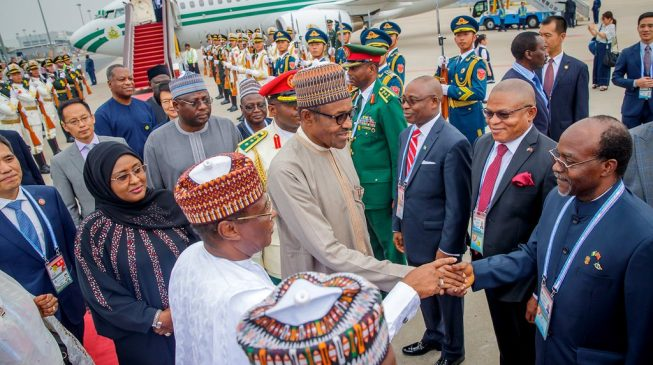 Buhari off to China with wife, daughter