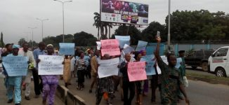 Pensioners block convoy of finance minister over 14 years' arrears