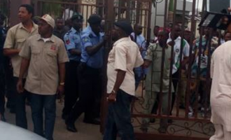 Police fire teargas at NHIS workers, escort suspended ES into office